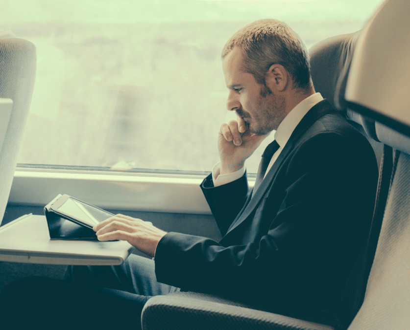 Man working on his laptop while on a Train Business Travel