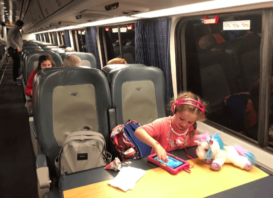 kid sitting in a train